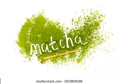 Word matcha made of powdered matcha green tea and bamboo spoon on white background. Copy space