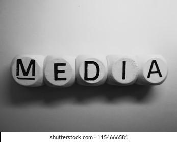 word media spelled on dice