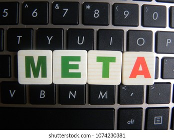 Word Meta on keyboard background