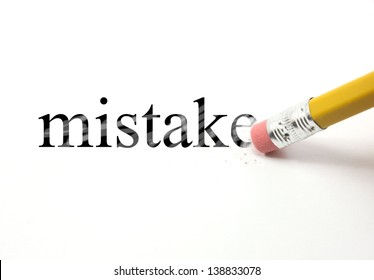 The word mistake written with a pencil on white paper.  An eraser from a pencil is starting to erase the word mistake.