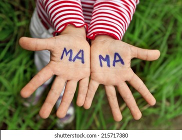 The word mom written in children's hands