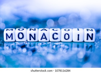 Word MONACOIN formed by alphabet blocks on mother cryptocurrency