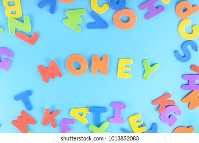 The word Money is made of multicolored letters. Beautiful bright inscription on a blue background.