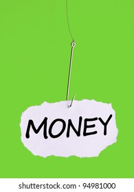 Word MONEY on a fishing hook on green background