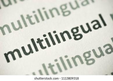 word multilingual printed on white paper macro
