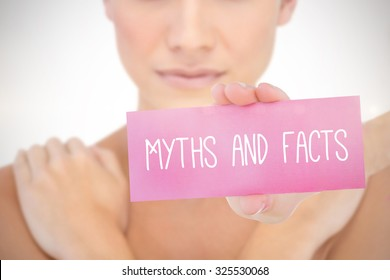 The word myths and facts and young woman holding blank card against white background with vignette