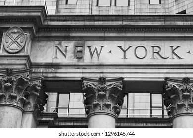 Word New York on the old building facade in NYC, USA