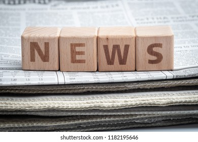 The word NEWS on wooden block