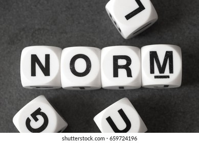 word norm on white toy cubes