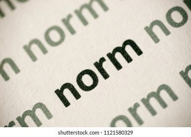 word norm printed on white paper macro