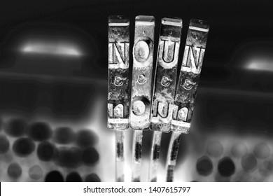 the word NOUN  with old typwriter keys  monochrome