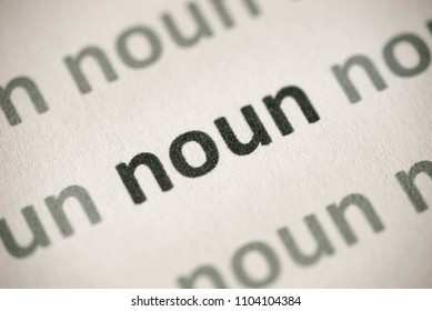 word noun printed on white paper macro