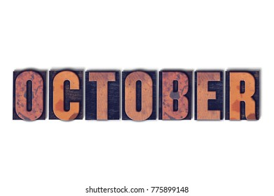 The word October concept and theme written in vintage wooden letterpress type on a white background.
