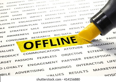Word OFFLINE highlighted with marker on paper of other related words. For direction of business marketing concept