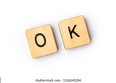 The word OK spelt out with wooden lettered tiles.