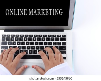 Word ONLINE MARKETING on laptop screen. Technology concept