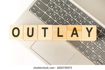 Word outlay. Wooden cubes with letters isolated on a laptop keyboard. Business Concept image.
