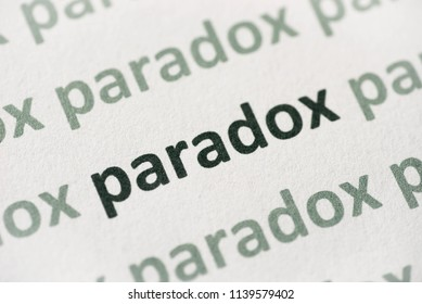 word paradox printed on white paper macro