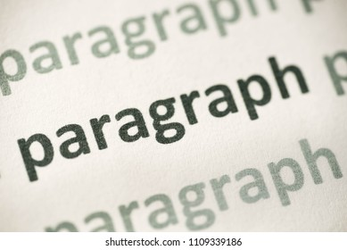 word paragraph printed on white paper macro