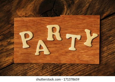 the word PARTY on wood