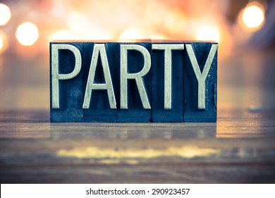 The word PARTY written in vintage metal letterpress type on a soft backlit background.