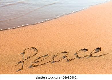 Word Peace on sand