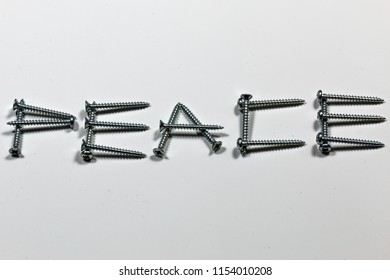 The word peace written with screws on a white background with reflections