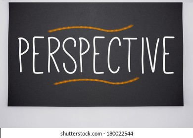 The word perspective written on big blackboard