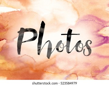 "The word ""Photos"" painted in black ink over a colorful watercolor washed background concept and theme."
