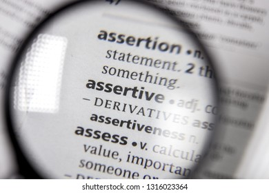 The word or phrase assertive in a dictionary.
