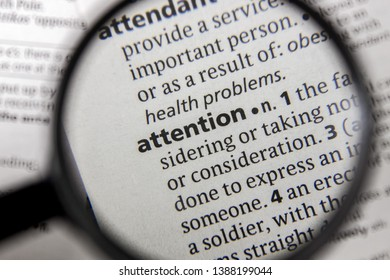The word or phrase attention in a dictionary book.
