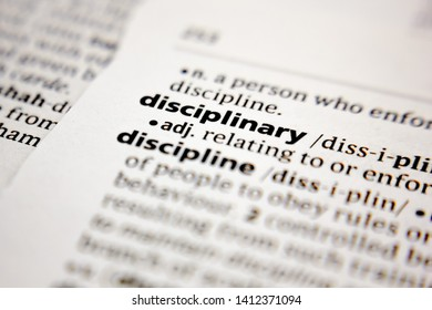 Word or phrase disciplinary in a dictionary.