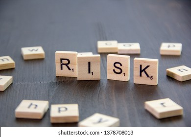 Word or phrase Risk made with scrabble letters.