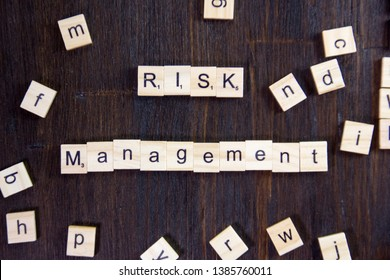 Word or phrase Risk Management made with scrabble letters.