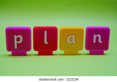 The word 'plan' spelt in letters isolated on green