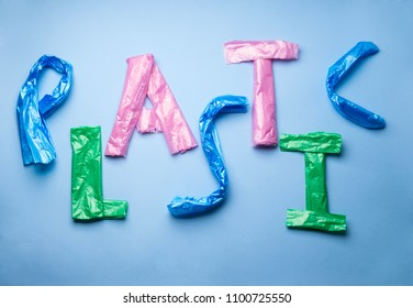 Word Plastic written with plastic bag letters on blue background