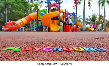 """The word """"playground"""" is placed on the playground area. A concept with a playground as a background."""