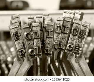 the word POLITICS with old typwriter keys  monochrome isolated