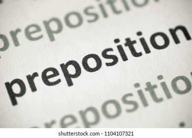 word preposition printed on white paper macro