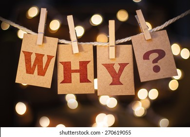 The word WHY? printed on clothespin clipped cards in front of defocused glowing lights.