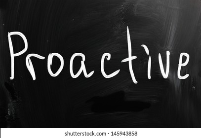 The word 'Proactive' handwritten with white chalk on a blackboard