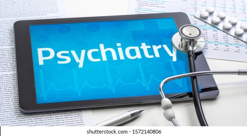 The word Psychiatry on the display of a tablet