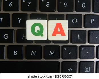 Word QA (Quality Assurance) on keyboard background