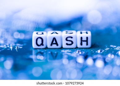 Word QASH formed by alphabet blocks on mother cryptocurrency