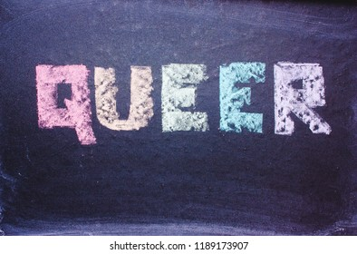 word Queer on a chalkboard, a symbol of LGBT, the colors of the rainbow