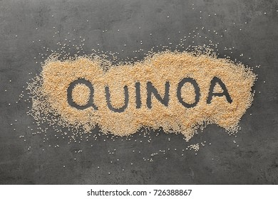 Word QUINOA written on scattered seeds
