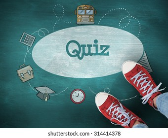 The word quiz and casual shoes against green chalkboard