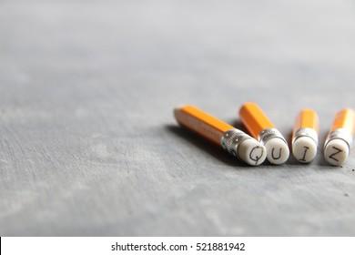 The word Quiz, inscription on pencil