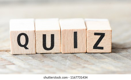 Word QUIZ. Wooden letters.