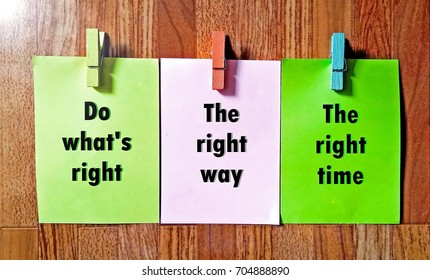 Word quotes of Do what's right, The right way, The right time on sticky color papers against wood pattern background.